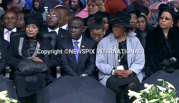 WINNIE MANDELA, NELSON'S DAUGHTER MAKAZIWE MANDELA AND NELSON'S WIDOW GRACA MACHEL(right)<br /> NELSON MANDELA MEMORIAL<br /> The nation mourns Nelson Rolihlahla Mandela Memorial Service, FNB Stadium, Johannesburg, South Africa<br /> Mandatory Credit Photo: &copy;NEWSPIX INTERNATIONAL<br /> <br /> **ALL FEES PAYABLE TO: &quot;NEWSPIX INTERNATIONAL&quot;**<br /> <br /> IMMEDIATE CONFIRMATION OF USAGE REQUIRED:<br /> Newspix International, 31 Chinnery Hill, Bishop's Stortford, ENGLAND CM23 3PS<br /> Tel:+441279 324672  ; Fax: +441279656877<br /> Mobile:  07775681153<br /> e-mail: info@newspixinternational.co.uk