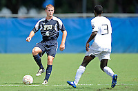 10 September 2011:  FIU's Joseph Dawkins (4) moves the ball upfield in the second half as the FIU Golden Panthers defeated the Stetson University Hatters, 3-2 in the second overtime period, at University Park Stadium in Miami, Florida.