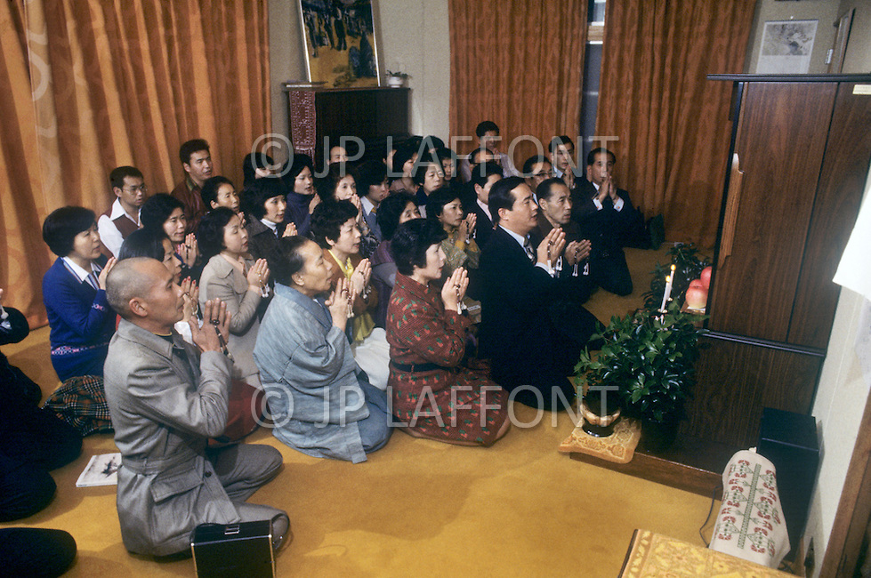 October, 1980. Tokyo, Japan. Followers of the Soka Gakkai religious group meet for religious teachings and prayer.