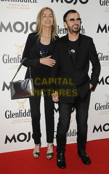 BARBARA BACH & RINGO STARR.The Glenfiddich MOJO Honours List award ceremony, the Brewery, Chiswell St., London, England..July 21st, 2011.full length couple beard facial hair sunglasses shades jeans denim black jacket top silver bag purse .CAP/CAN.©Can Nguyen/Capital Pictures.