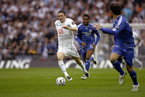 24 February 2008: Tottenham striker Robbie Keane runs with the ball during the Carling Cup Final between Tottenham Hotspur and Chelsea, played at Wembley Stadium. Spurs won the game 2-1 after extra time. Photo: Actionplus....080224 football soccer player joy