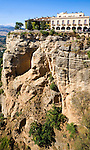 Historic National Parador hotel building perched on sheer cliff top in Ronda, Spain