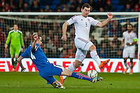 Wednesday 05 March 2014<br /> Pictured:( L-R) Eggert Gunnthor Jonssson tackles Sam Vokes<br /> Re: International friendly Wales v Iceland at the Cardiff City Stadium, Cardiff,Wales UK
