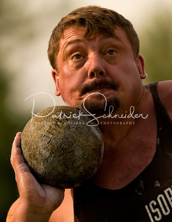A competitor throws the shot put rock in the heavy Scottish Athletic Events during the 52nd Annual Grandfather Mountain Highland Games in Linville, NC.
