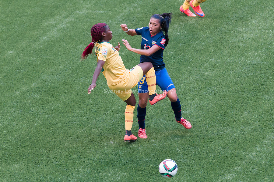 June 8, 2015: Madeleine NGONO MANI of Cameroon and Kerlly REAL of Ecuador fight for the ball during a Group C match at the FIFA Women's World Cup Canada 2015 between Cameroon and Ecuador at BC Place Stadium on 8 June 2015 in Vancouver, Canada. Sydney Low/AsteriskImages