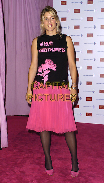 GUEST.Attends A Touch Of Pink Party,.madame tussards, London.England, October 5th 2006..half length Couple fiancefull length slogan top black tights shoes skirt.Ref: CAN.www.capitalpictures.com.sales@capitalpictures.com.©Can Nguyen/Capital Pictures