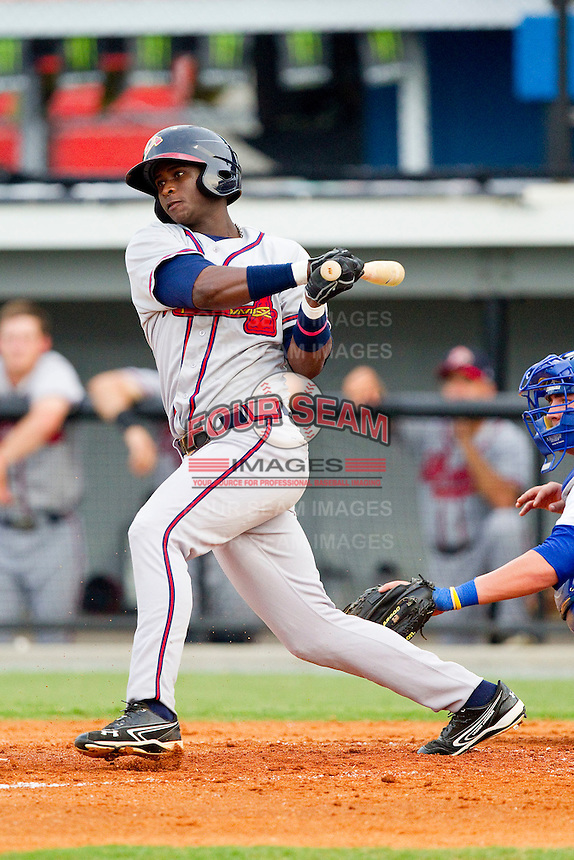 Felix Marte (5) of the Danville Braves follows through on his swing against the Burlington Royals at Burlington Athletic Park on July 18, 2012 in Burlington, North Carolina.  The Royals defeated the Braves 4-3 in 11 innings.  (Brian Westerholt/Four Seam Images)