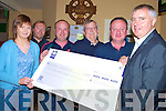 Shane O'Callaghan, Kilcummin GAA Club, third from left, pictured presenting a cheque of EUR10,000 to Sean Sheehan, Keel and London,right, winner of the clubs development draw in the Clubhouse on Tuesday night. Also pictured are Maire Devane, John Fitzgerald, Denis O'Connor and Tim Casey...NO FEE...NO FEE........