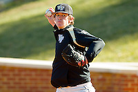 Jack Fischer #15 of the Wake Forest Demon Deacons throws in the bullpen at Wake Forest Baseball Park on January 29, 2012 in Winston-Salem, North Carolina.  (Brian Westerholt / Four Seam Images)