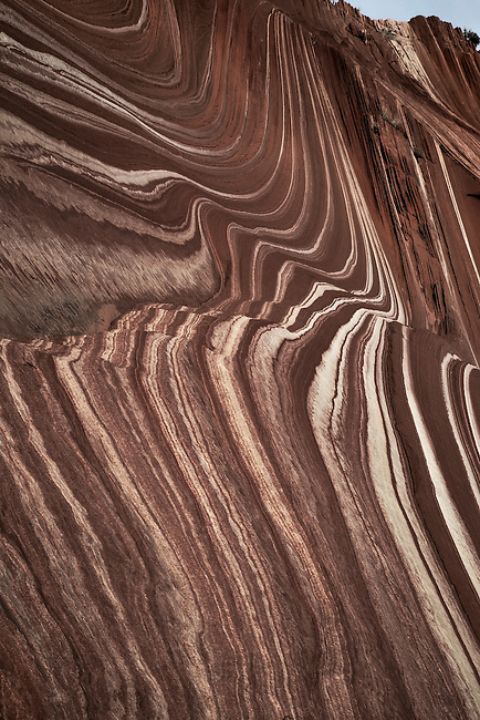 Parallel lines of eroded sandstone producing vivid colors make up the landscape at Sand Cove at North Coyote Buttes on the Arizona/Utah border.