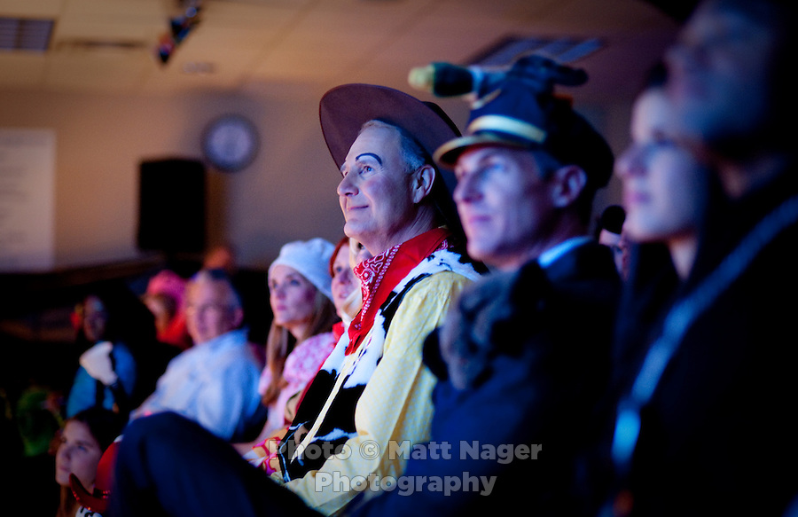 Southwest Airlines Chief Executive Officer and President Gary Kelly (cq), dressed as Woody from Toy Story, watched skits performed by each department during the Southwest Airlines annual Halloween festivities at the headquarters building near Love Field Airport in Dallas, Texas, Friday, October 29, 2010...PHOTO/ MATT NAGER
