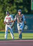 20 August 2015: Tri-City ValleyCats catcher Anthony Hermelyn (right) returns to the dugout with Pitching Coach Chris Holt (20) after warming up his starting pitcher prior to a game against the Vermont Lake Monsters at Centennial Field in Burlington, Vermont. The Stedler Division-leading ValleyCats defeated the Lake Monsters 5-2 in NY Penn League action. Mandatory Credit: Ed Wolfstein Photo *** RAW Image File Available ****