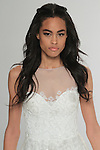 "Beauty shot: model walks runway in Epona - an off white A-line dress in silk-embroidered tulle with crystal embellishments, sweetheart neckline and a gathered waist, from the Tony Ward Fall 2016 ""A Mid-Summer Night's Dream"" bridal collection on April 18, 2016 at Kleinfeld Bridal during New York Bridal Fashion Week Spring Summer 2016."