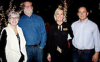 NWA Democrat-Gazette/CARIN SCHOPPMEYER  Lynn and Joel Carver (from left) and Katrina and Lance Osborne visit at the Arkansas Support Network benefit.