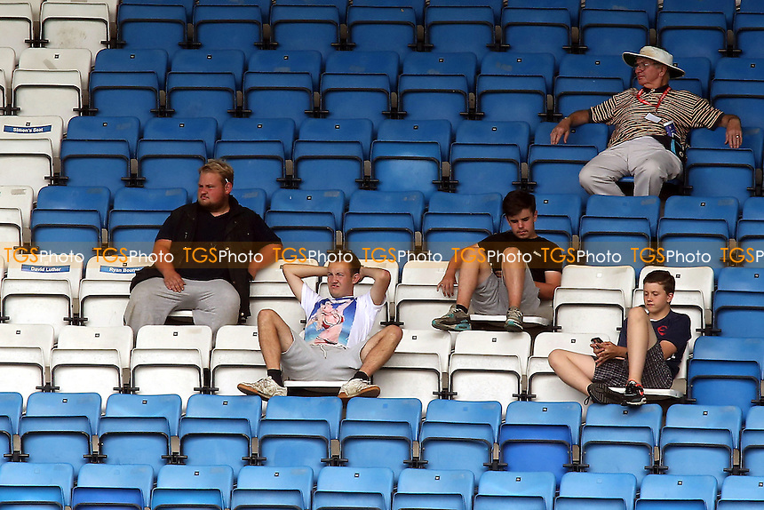 Gillingham fans relax in their seats during the pre-season friendly against Ipswich Town - Gillingham vs Ipswich Town - Pre-Season Friendly Football Match at Priestfield Stadium, Gillingham, Kent - 26/07/14 - MANDATORY CREDIT: Paul Dennis/TGSPHOTO - Self billing applies where appropriate - contact@tgsphoto.co.uk - NO UNPAID USE