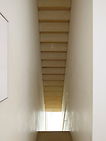 The underside of a limestone staircase greets you as you enter the house