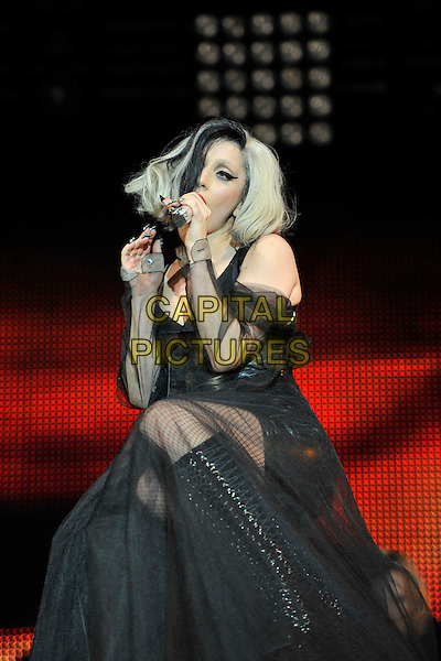 LADY GAGA (Stefani Joanne Angelina Germanotta).Performing live at Radio 1's Big Weekend, Carlisle, England, UK..May 15th 2011.stage concert live gig performance music full singing boots length pvc shiny leather  tulle  dress gown sitting   .CAP/MAR.© Martin Harris/Capital Pictures.