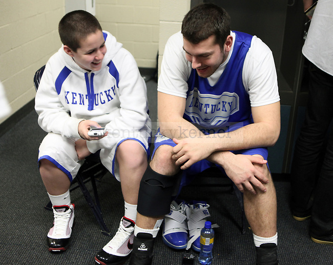Senior Josh Harrellson talks with Brad Calipari in the locker room before an open practice before UK's first round of the NCAA tournament at New Orleans Arena on Wednesday, March 17, 2010. Photo by Britney McIntosh | Staff