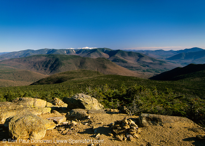 Scenic view of the Pemigewasset Wilderness in the New Hampshire White Mountains from Mount Liberty. Owl's Head is in the middle of the scene, and Mount Washington is snow-capped. The area around Owl's Head was logged during the East Branch & Lincoln Railroad era (1893-1948).