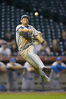 Third baseman Tyler Rahmatulla #5 of the UCLA Bruins makes an off balance throw to first base versus the Rice Owls in the 2009 Houston College Classic at Minute Maid Park February 27, 2009 in Houston, TX.  The Owls defeated the Bruins 5-4 in 10 innings. (Photo by Brian Westerholt / Four Seam Images)