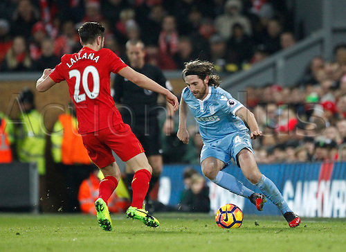 27.12.2016. Anfield, Liverpool, England.  EPL Premiership football, Liverpool versus Stoke. Stoke City midfielder Joe Allen takes on Liverpool midfielder Adam Lallana.