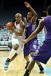 21 December 2013: North Carolina's Xylina McDaniel (34) and High Point's Stacia Robertson (4). The University of North Carolina Tar Heels played the High Point University Panthers in an NCAA Division I women's basketball game at Carmichael Arena in Chapel Hill, North Carolina. UNC won the game 103-71.