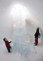Sweden, SWE, Kiruna, 2006-Apr-12: A woman and a four years old girl standing in front of a sculpture made of ice in the Jukkasjarvi icehotel.
