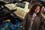 Her face tells the story as welfare recipient Bette Hendricks loads up the back of her car after a visit to the Food Bank in rural Earlimart, in central California.