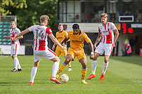 Joss Labadie of Newport County gets between Asa Hall and Harry Pell of Cheltenham during the Sky Bet League 2 match between Newport County and Cheltenham Town at Rodney Parade, Newport, Wales on 10 September 2016. Photo by Mark  Hawkins / PRiME Media Images.