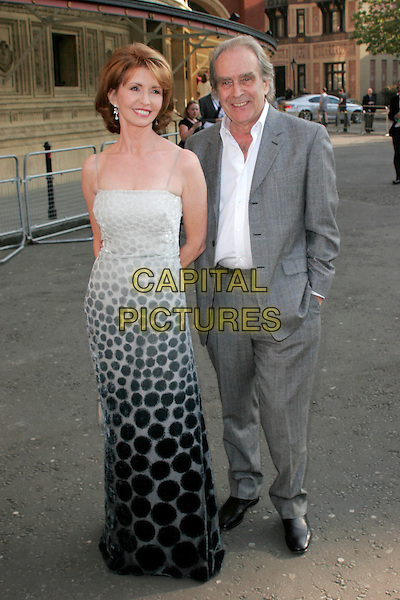JANE ASHER & GERALD SCARFE.Arrivals for the Classical Brit Awards 2008 held at the Royal Albert Hall, London, England, UK..May 8th, 2008.full length grey gray suit black print dress dip dye circles pattern bag purse gold .CAP/AH.©Adam Houghton/Capital Pictures.