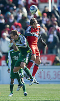 26 March 2011: Portland Timbers defender Kevin Goldthwaite #2 and Toronto FC forward Alan Gordon #21in action during an MLS game between the Portland Timbers and the Toronto FC at BMO Field in Toronto, Ontario Canada..Toronto FC won 2-0....