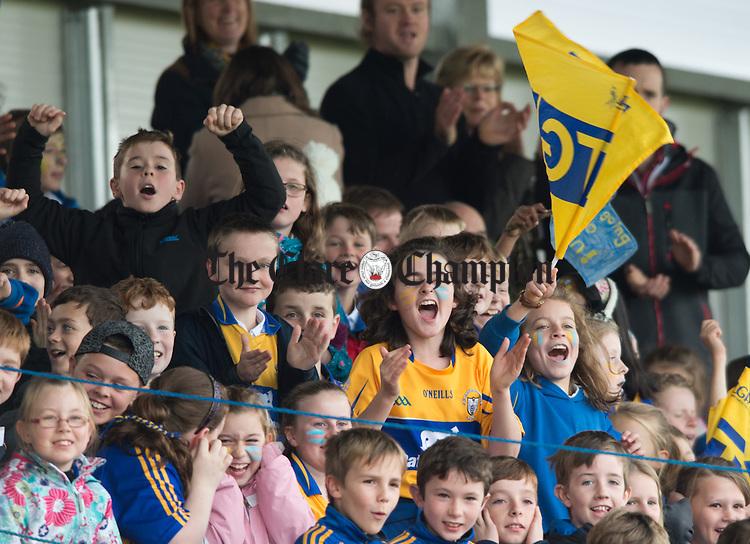 Ennis CBS fans cheer on their team at the Cumann na mBunscoil Finals at Cusack Park. Photograph by John Kelly.