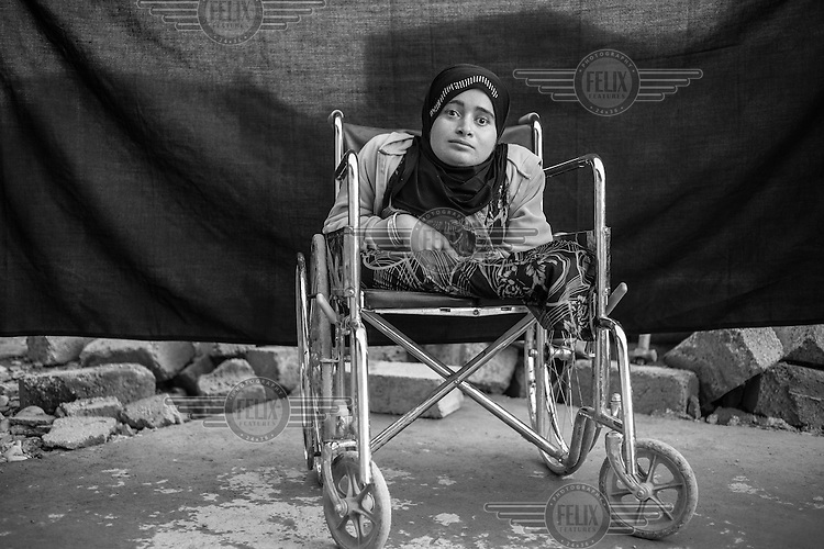 Alia (name changed to protect her identity), 24, in the Domiz refugee camp in the Kurdistan Region of Iraq. Alia was living with her family in Daraa, Syria, when fighting forced them to flee their home four months earlier. As the fighting drew closer, she recalls, 'It was terrifying because I'm not able to help myself.' Confined to a wheelchair and blind in both eyes, Alia says she was terrified by what was happening around her. 'At the beginning of the fighting, my family decided to stay because we thought it would be over soon. But as it went on, I was scared that they might run away and leave me at home alone.' Although she never cared for television, Alia began to follow the news programmes closely as the fighting intensified, because it helped her make sense of the things she heard (but couldn't see) going on around her. 'Men in uniforms came and killed our cow. They fought outside our house and there were many dead soldiers. I cried and cried, scared because I had to call my family even to know what was happening.' Alia says the only important thing that she brought with her 'is my soul, nothing more - nothing material.' When asked about her wheelchair, she seemed surprised, saying that she considers it an extension of her body, not an object. 'I am happy. I am happy to be safe, to be here with my family,' she says.