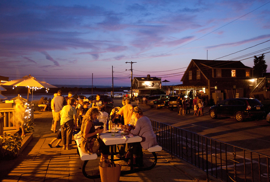 Diners gather outside The Home Port restaurant in Menemsha on Martha's Vineyard...
