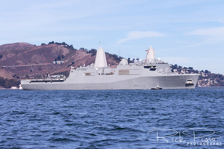 USS San Diego (LPD-22), a San Antonio-class Amphibious Transport Dock, enters San Francisco Bay with its crew lining the rail.