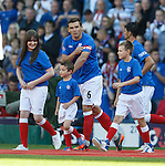 New club captain Lee McCulloch leads out the teans and the mascots