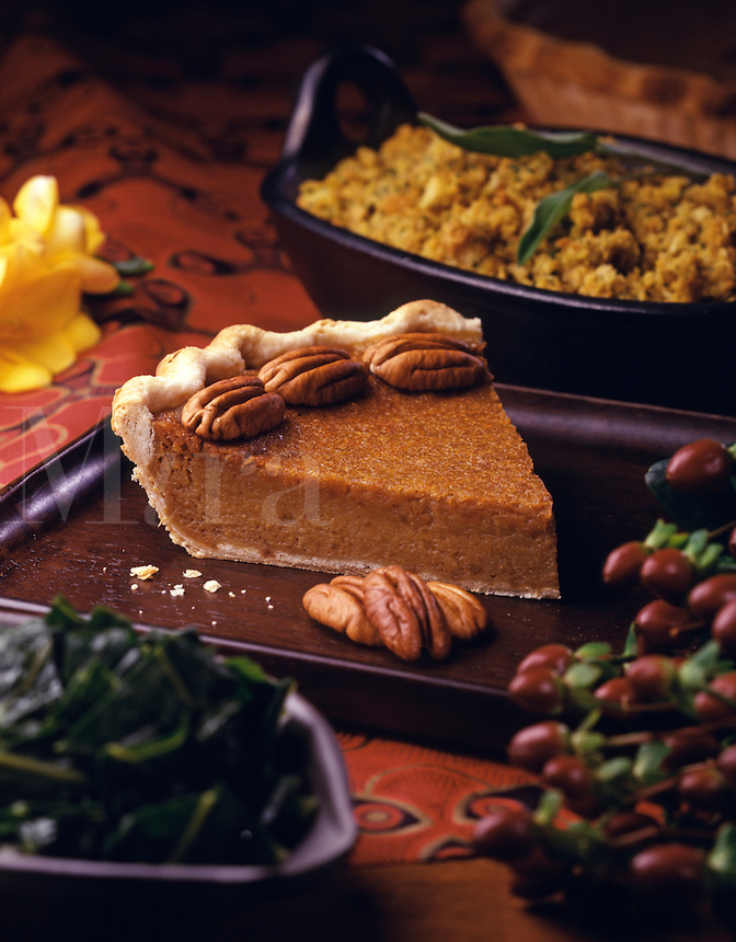slice of pumpkin pie decorated with pecans