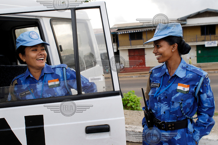 LIBERIA, Monrovia, 05/04/2007..Itee (left) and Jayshree share a joke together before going on a Joint Task Force patrol...© 2007 Aubrey Wade. All rights reserved.