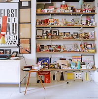 Above an Ikea cabinet in Carin Goldberg's studio is a poster by Uwe Loesch and the shelves display her collection of packaging and curios