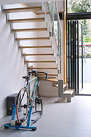 There is plenty of room underneath the staircase to store a bicyle