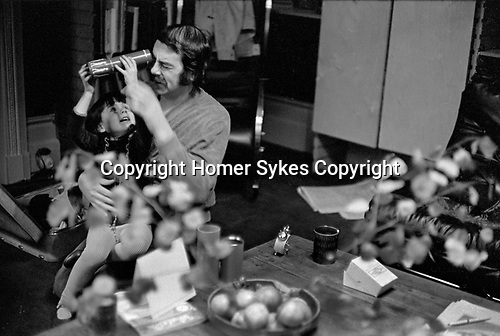 David Hurn Porchester Court flat Bayswater London 1970, with daughter Sian.
