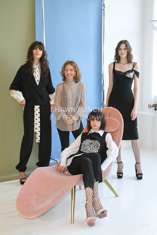 Fashion designer Denitza Skorcheva (Center) poses with models during her Roumel6 Fall 2017 collection fashion presentation, at Drift Studios on 508 West 26 Street, on February 8, 2017, during New York Fashion Week Women Fall 2017.