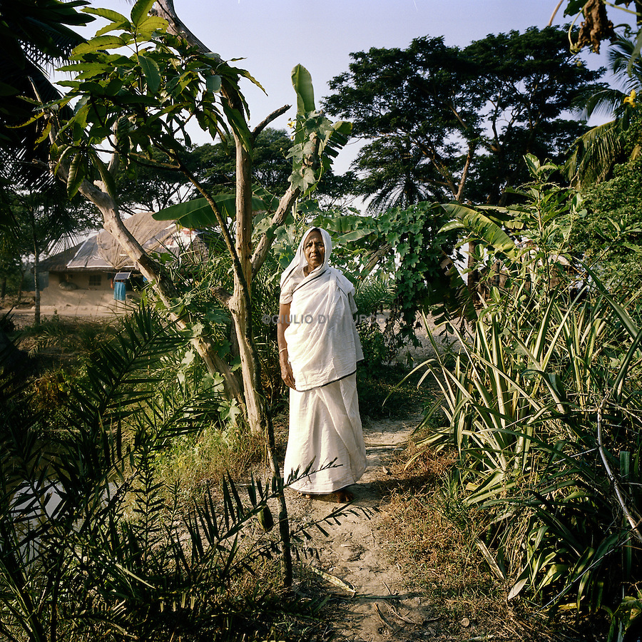 Sudhanya Khali, Unesco reserve in the Sundarban with more than 100 islands,home to the largest mangrove forest in the world, 9 December 2010..Bamuni Mondol, 55 years, tiger widow, her husband was Killed by a tiger 10 years ago.