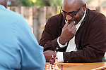 African American men playing chess