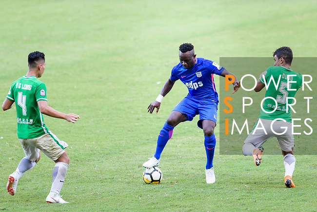 Kitchee Forward Alex Akande (C) in action against Luis Eduardo Chebel Klein Nunes of Wofoo Tai Po (R) during the Hong Kong FA Cup final between Kitchee and Wofoo Tai Po at the Hong Kong Stadium on May 26, 2018 in Hong Kong, Hong Kong. Photo by Marcio Rodrigo Machado / Power Sport Images