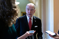 United States Senator Chuck Grassley (Republican of Iowa) speaks to members of the media as he leaves the Senate Chamber at the United States Capitol in Washington D.C., U.S. on Tuesday, March 24, 2020.  The Senate is working to finalize a deal on the Coronavirus Stimulus Package, after it was blocked by Senate Democrats two days in a row.  Credit: Stefani Reynolds / CNP/AdMedia