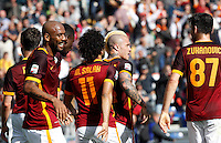 Calcio, Serie A: Roma vs Napoli. Roma, stadio Olimpico, 25 aprile 2016.<br /> Roma&rsquo;s Radja Nainggolan, second from right, celebrates with teammates after scoring the winning goal during the Italian Serie A football match between Roma and Napoli at Rome's Olympic stadium, 25 April 2016. Roma won 1-0.<br /> UPDATE IMAGES PRESS/Riccardo De Luca