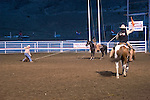 WY: Wyoming, Cody..Cody Night Rodeo..Photo #: yellow921..Photo copyright Lee Foster, 510/549-2202, lee@fostertravel.com, www.fostertravel.com..
