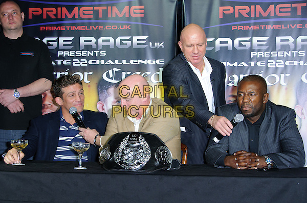 Alex Reid & Jason Barrett.Alex Reid makes announcement about forthcoming Cage Fight, London, England..July 20th, 2011.half length blue  white striped stripes top jacket black table microphone glass drunk beverage champagne .CAP/CJ.©Chris Joseph/Capital Pictures.
