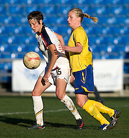 USWNT forward (15) Megan Rapinoe shields the ball away from Swedish defender (4) Anna Paulson during the Algarve Cup final at the Estadio Algarve in Faro, Portual.  The USWNT lost to Sweden on penalty kicks after it was tied in regulation at 1-1.